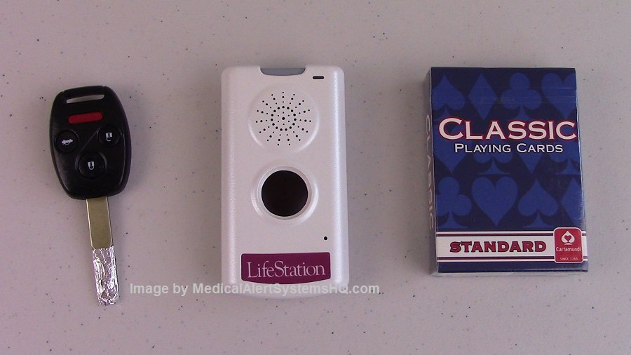 LifeStation Mobile Emergency Button next to deck of cards